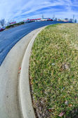 Road curb with grass lawn and pavement in a city — Stock Photo