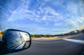 Driving in car on highway,with views in windshiel and side window — Stock Photo