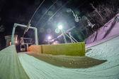 Unloading at ski lift at night while snowing — Stock Photo