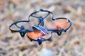 Remote controlled quadcopter drone in mid air — Stock Photo #40669311