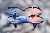 Remote controlled quadcopter drone in mid air — Stock Photo