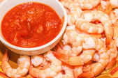Fresh Organic Shrimp Cocktail with red sauce on dinner table — Стоковое фото