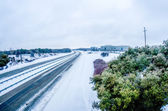 Highway covered in snow and sleet without traffic — Stock Photo