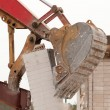 Wreck excavator at work demolishing a building wall — Stock Photo #45212057