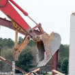 Wreck excavator at work demolishing a building wall — Stock Photo #45212063