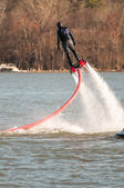 Extreme sports of water jetpack flyboarding — Stock Photo