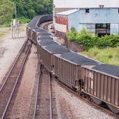 Slow moving Coal wagons on railway tracks — Stock Photo