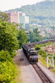 Slow moving Coal wagons on railway tracks — Stock Photo