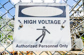 White and black danger warns trespassers away from this substati — Stock Photo
