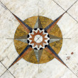 Stock Photo: Detail of wind rose in marble near Monument to portugu