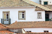 Detail of some buildings and roof tiles at a little portuguese v — Stock Photo
