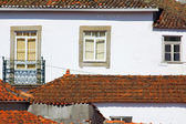Roof tiles and windows — Stock Photo