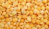 Dry split yellow peas texture background — Stock Photo