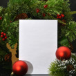 Christmas Background.Blank Paper Sheet with Decoration - Stock Photo