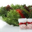 Baby boots and christmas wreath - Stock Photo