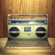 Vintage stereo player in wooden background. - Stok fotoğraf