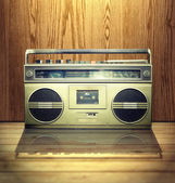 Vintage stereo player in wooden background. — Stock Photo