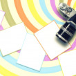 Blank card and vintage camera on colored spiral line background. — Stock Photo