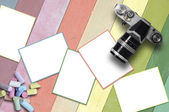 Blank card and vintage camera with pastel chalk on colored line background. — Stock Photo