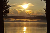 Sunset on the River in the fog — Stock Photo