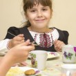 School girl eats in a dining room — Foto Stock
