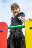 Girl on the playground's bridge — Stock Photo