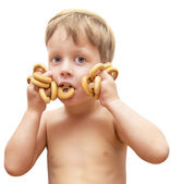 Cute boy with bagels — Stock Photo