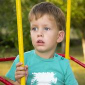 Little boy on swing — Stock Photo