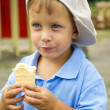 Little boy in cap with ice cream — Stock Photo