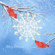 Christmas vector background with red birds (cedar waxwings), white snowflake cut from paper, snow-covered frozen tree brunches, snowfall, text 'Merry Christmas' on a blue backdrop — Stockvector
