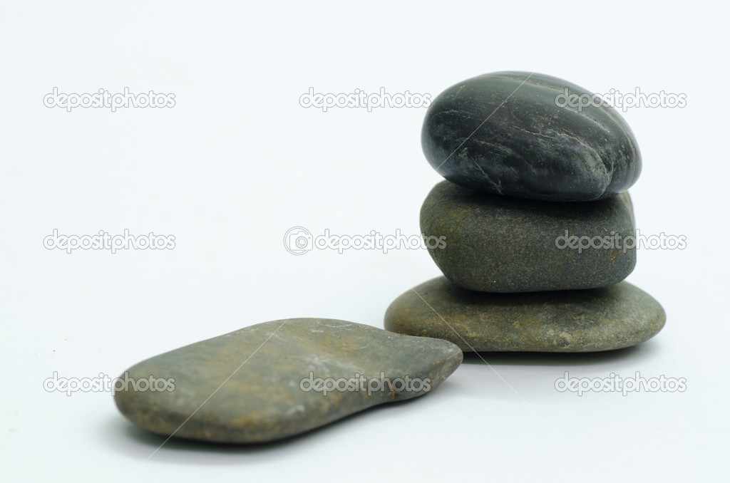 Stacked rocks and one isolated rock — Stock Photo #12011064