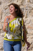 Happy woman with bottle of water laughing. — Stock Photo