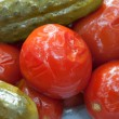 Marinaded tomatos and cucumbers — Stock Photo