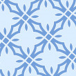 Christmas seamless pattern from white snowflakes — Stock Photo