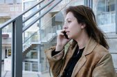 Business woman talking on cellphone — Stock Photo