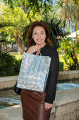 Young happy woman with shopping bag — Stock Photo