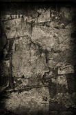 Torn Paper on old wall — Stock Photo