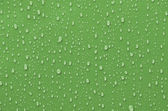 Water Droplets on Green Metallic Surface — Stock Photo