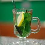 Tea with mint, lemon and cinnamon — Stock Photo