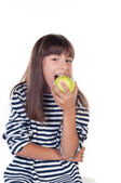 Happy cute girl with apple on white background — Stockfoto