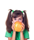 Little girl with grapefruit — Stock Photo
