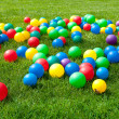 Heap of Colorful Balls on green grass — Stok Fotoğraf #29899847