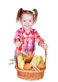 Little girl with basket of vegetables — Stock Photo