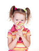 Cute little girl holding big lolly pop — Stock Photo