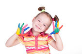 Beautiful little girl with hands in the paint — Stock Photo