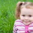 Cute little girl on the meadow — Stock Photo