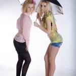 Two girls under black umbrella — Stock Photo