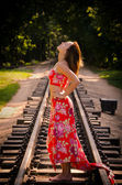 Girl on a railway — Stock Photo
