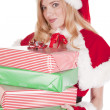 Mrs Santa smiling with presents — Stock Photo #12088376