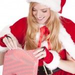 Mrs Santa wraps a gift — Stock Photo #12088393